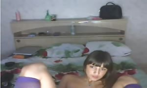 brown haired Russian woman is playing with her undressed vag