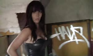 rubber suit looks horny on this brown haired prostitute with enormous jugs and strap on dildo dildo