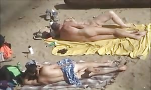 two couples having fun next to every over on beach