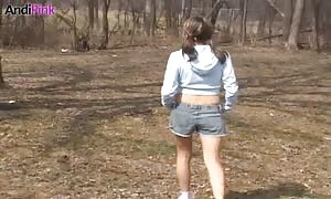Tanned honey Andi Pink is walking hot in the woods in denim jeans